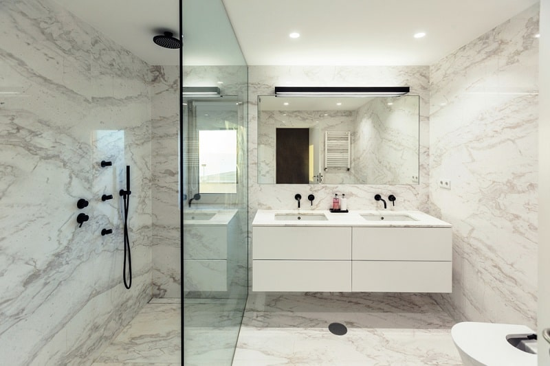 bathroom with marble tops